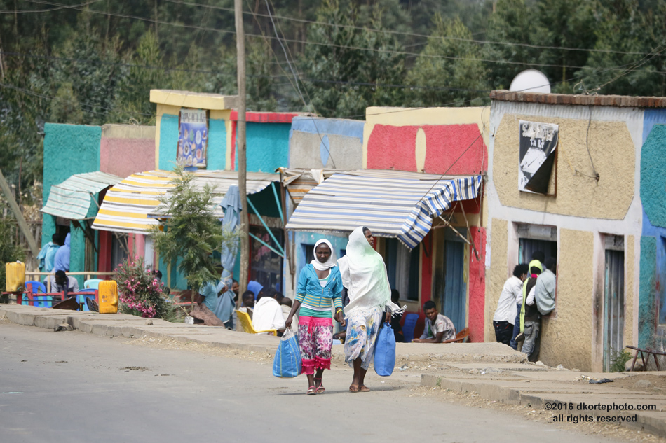 Walking main street. Village street, between Gondar and Debark, on the way to Simien Mountains.