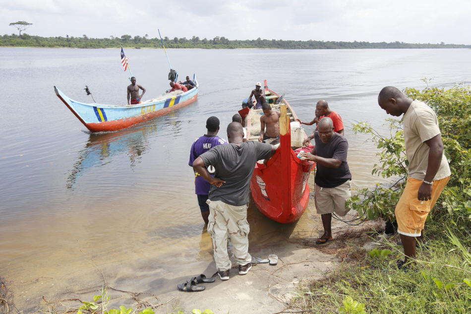 Boats arrive at a checkpoint for inspection by Liberian Fisheries.
