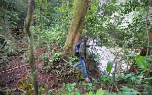 Kollie crosses a small ravine near the Sinoe River.
