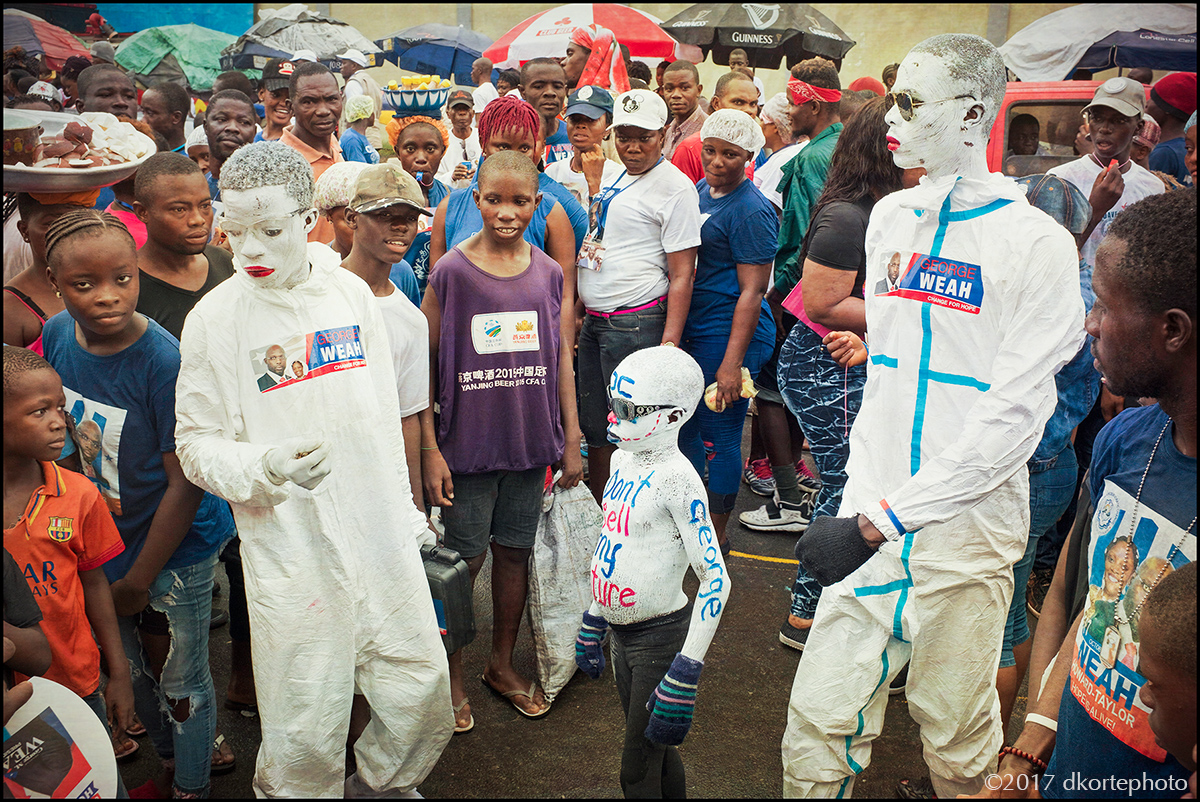 """""""Don't sell my future"""". Weah (CDC) supporters paint their statement at a rally ahead of the october 10 elections."""