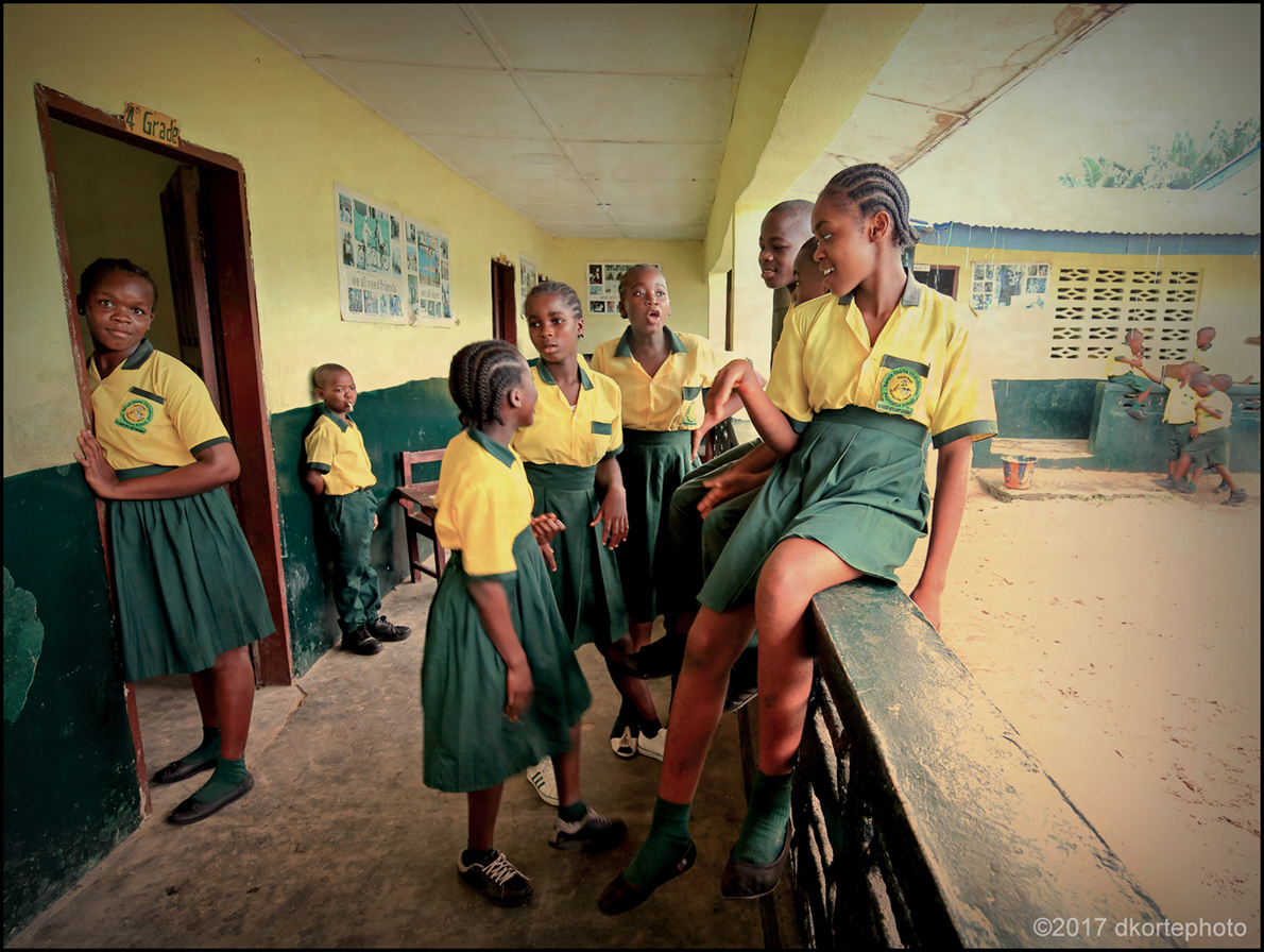 End of recess means back to class as schoolgirls linger after the bell.
