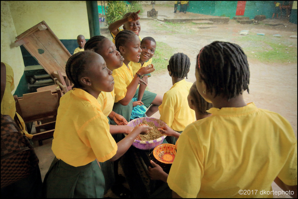 "Sistahz. Schoolgirls share their lunch ""family style"" with lively conversation."