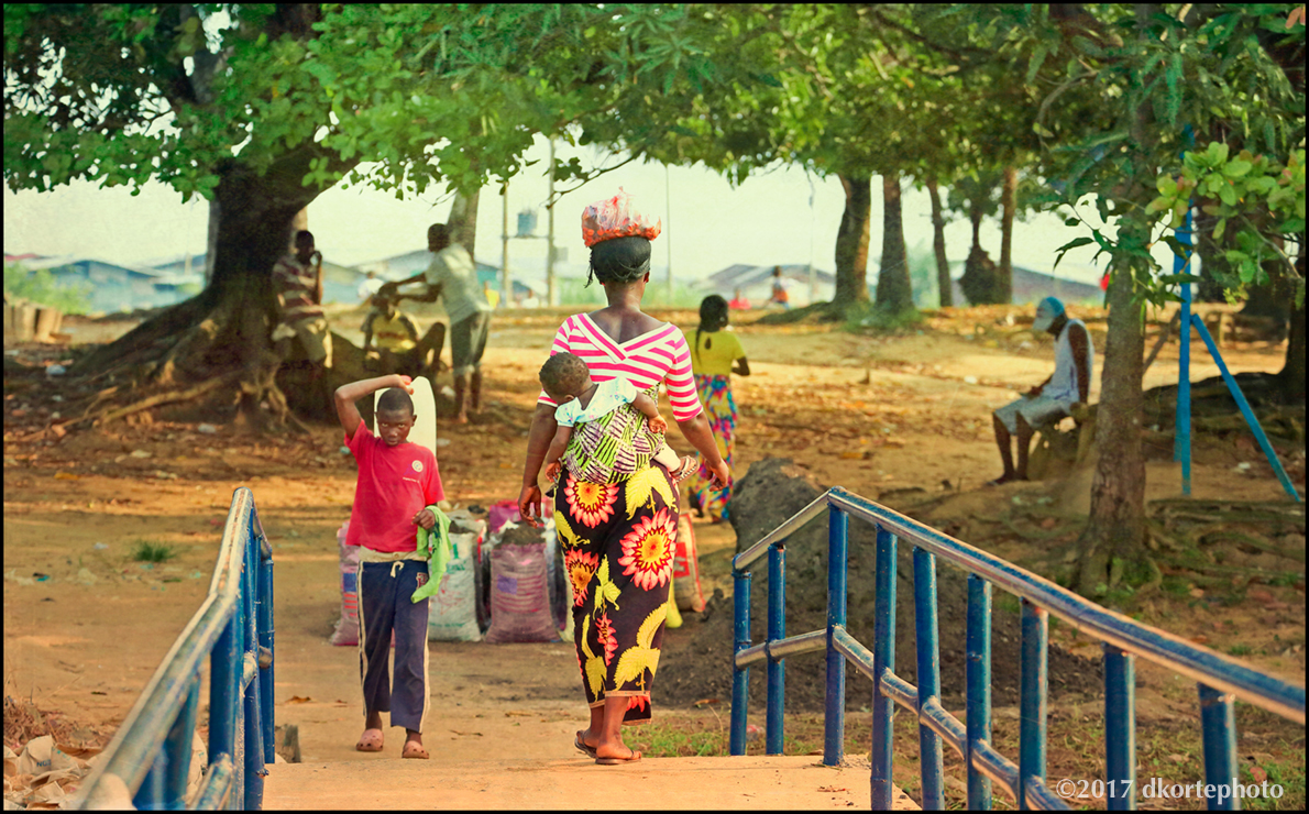 Footbridges carry people among the islands of the Mesurado River in Monrovia.