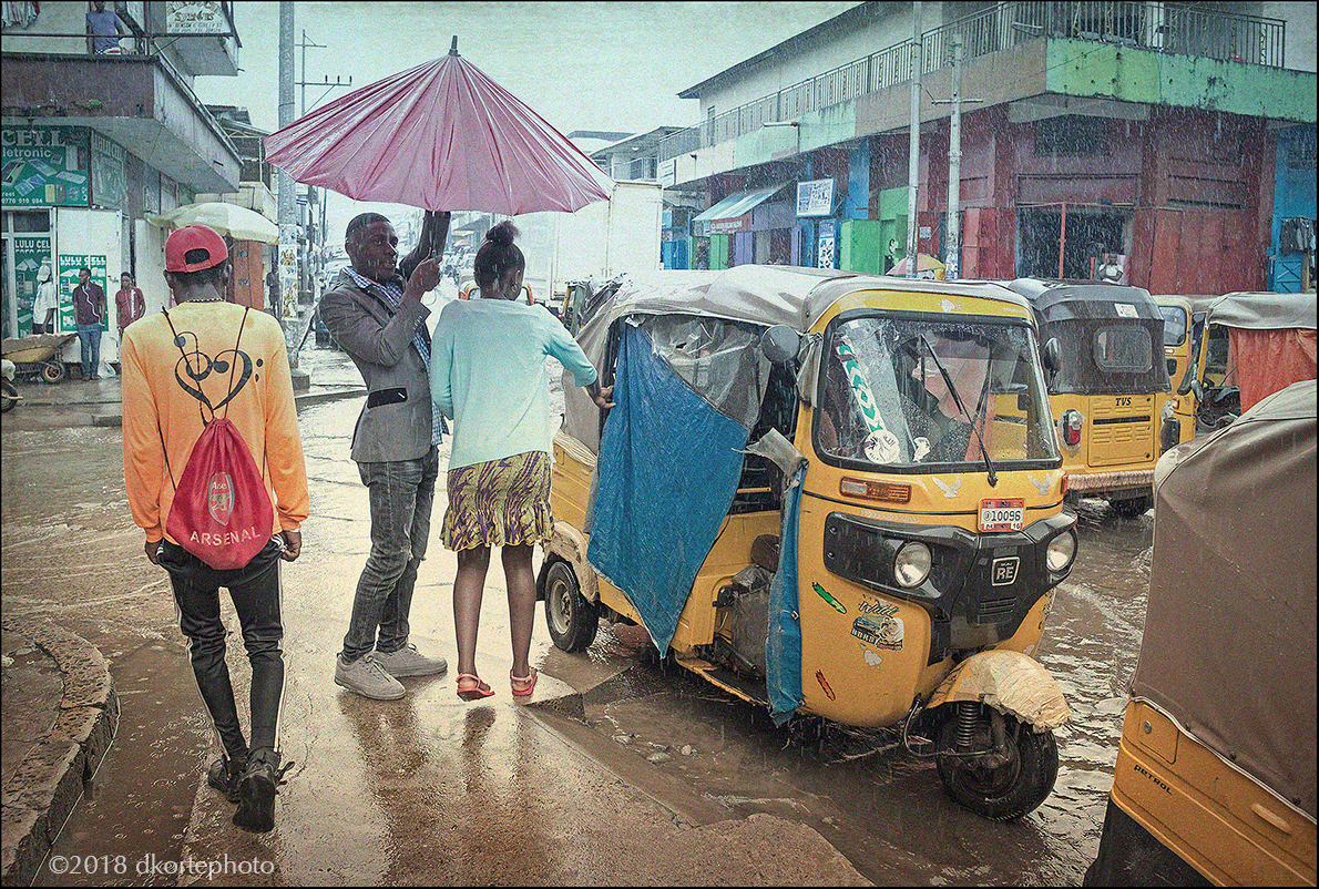 Dealing with rainy season. Monrovia, Liberia.